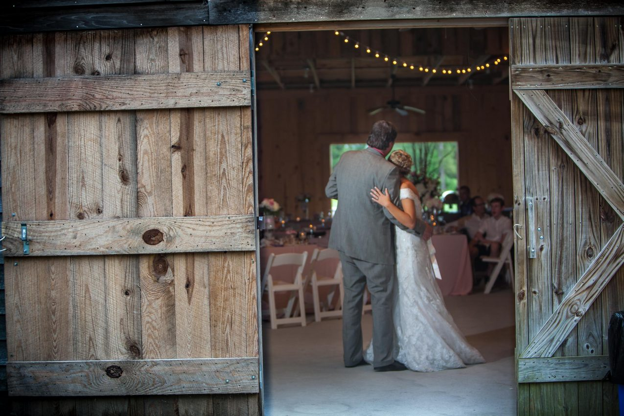 father and bride during first dance in a barn wedding on a farm in nebraska