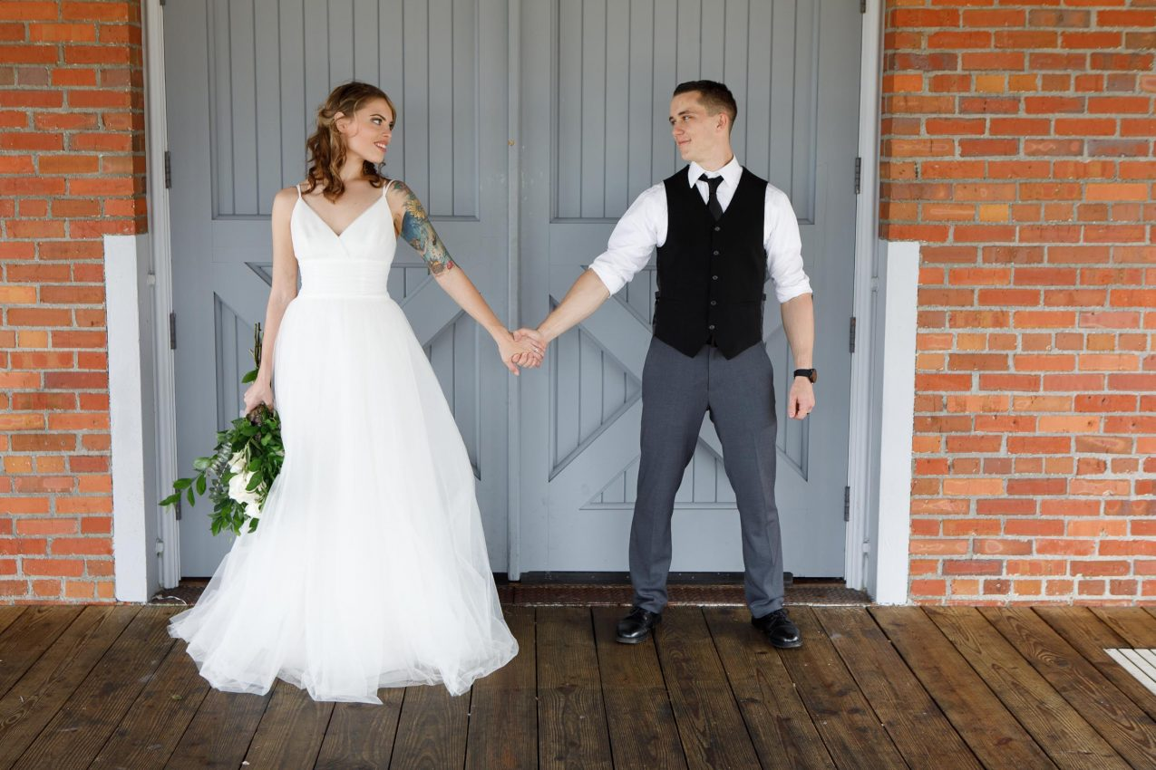 beautiful bride and groom in a traditional ceremony during a farm wedding in a barn in lincoln, nebraska